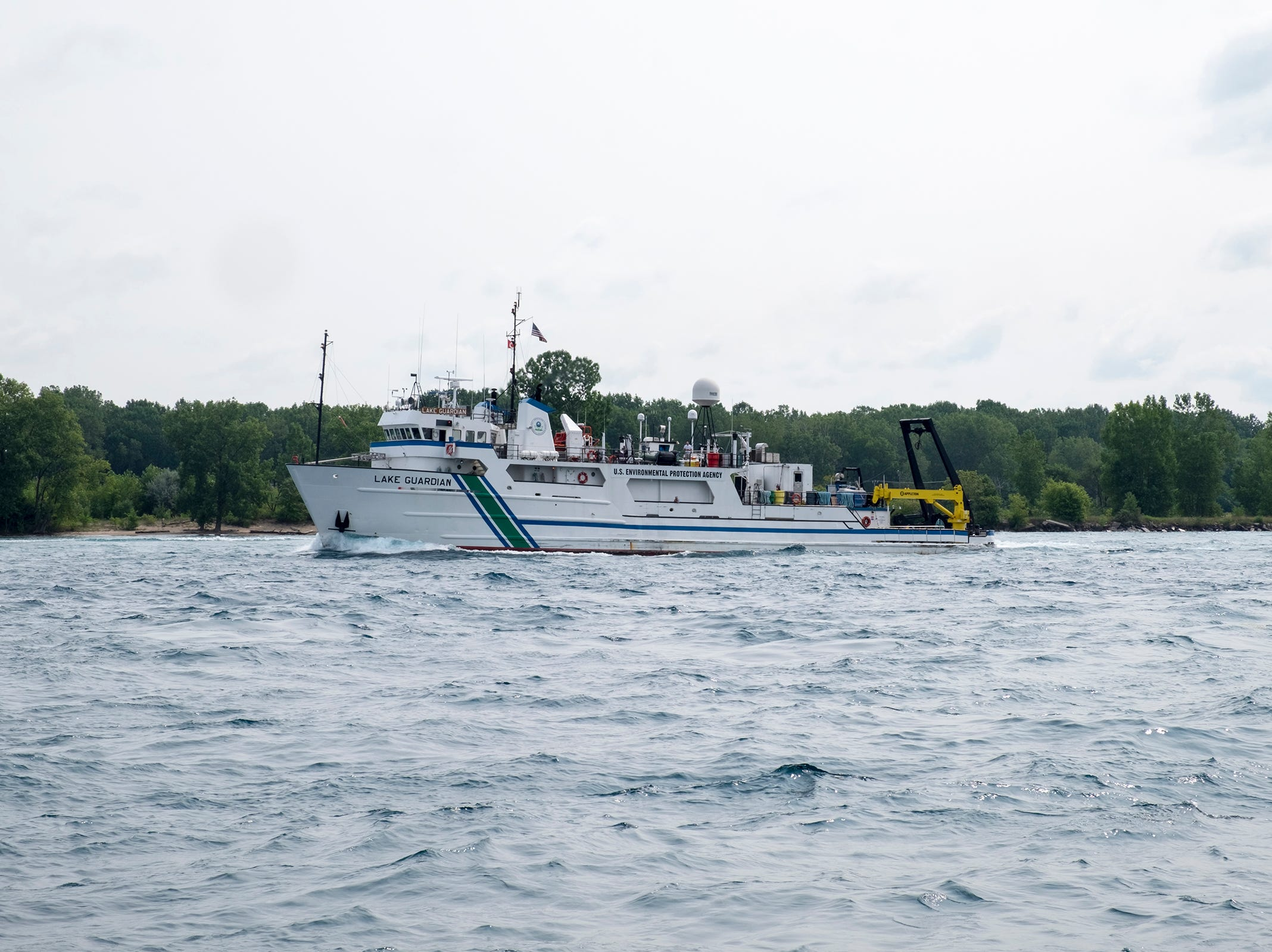 The U.S. Environmental Protection Agency Lake Guardian is seen upbound on the St. Clair River Sunday, Aug. 19, 2018, before the annual Float Down launches from Lighthouse Beach.