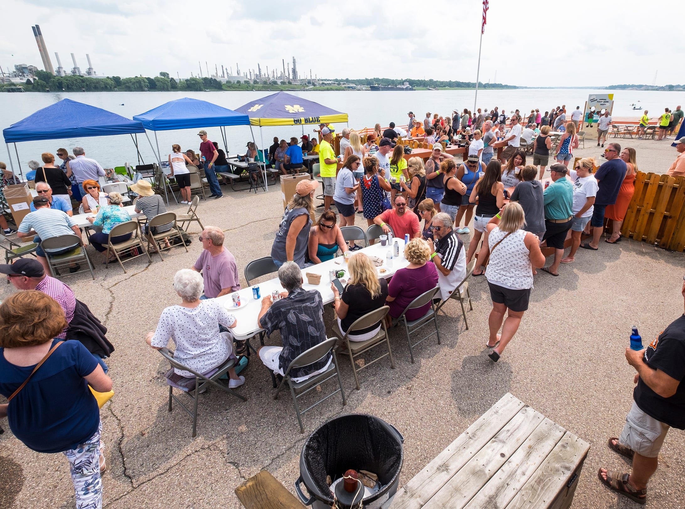 People hang out on the patio behind the Moose Lodge in Port Huron Sunday, Aug. 19, 2018, during the club's annual Float Down party.