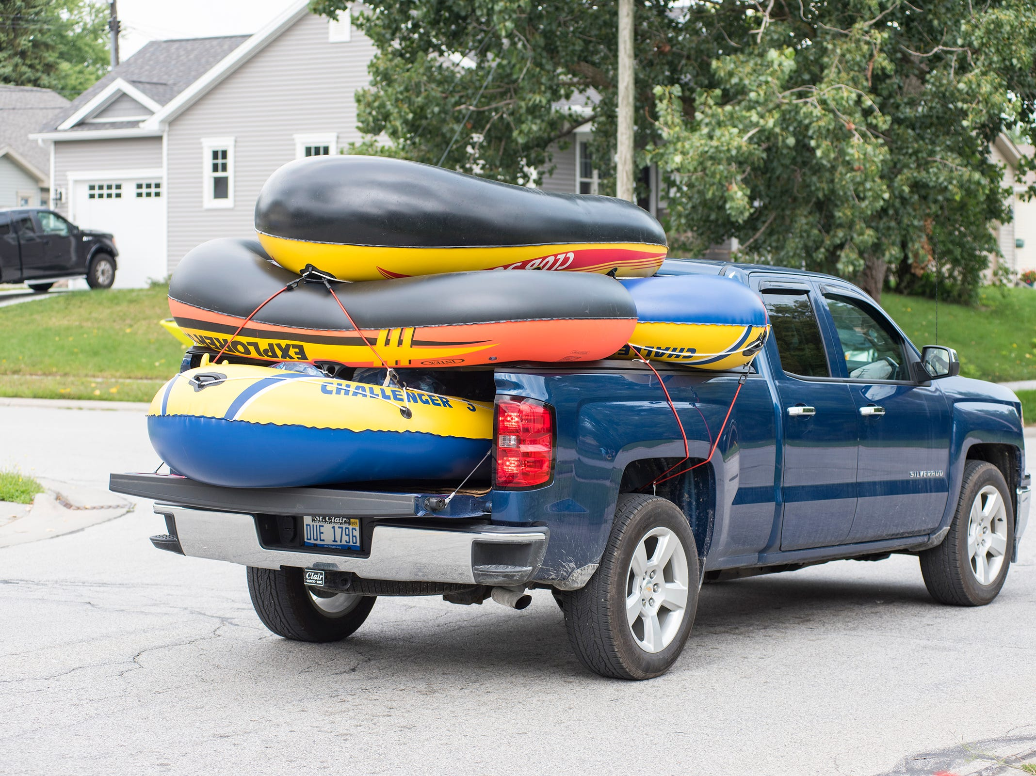 A truck carrying inflatable rafts heads to Lighthouse Beach Sunday, Aug. 19, 2018, before the annual Float Down launches.