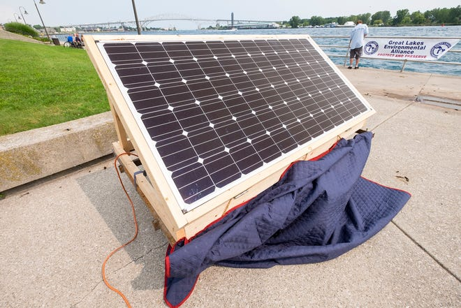 A solar panel is used to power a PA system Sunday, Aug. 19, 2018, at the Fourth Anual International Rally to Protect the Great Lakes.