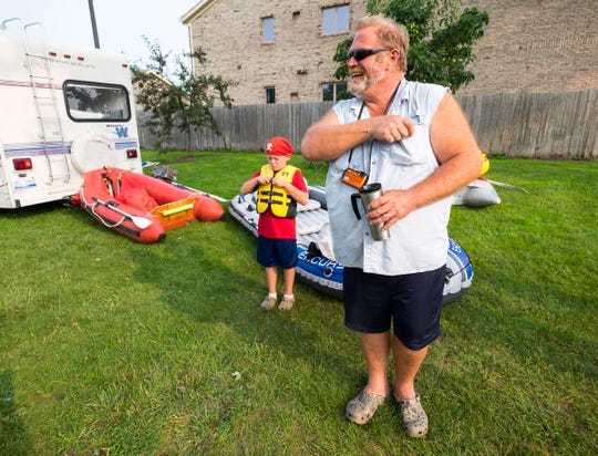 Richard Fairfield, right, talks about the flotation devices he and his group will be using in the annual Float Down Sunday, Aug. 19, 2018. Fairfield's grandson, Bryce Curry, 8, left, will be participating in his first Float Down this year.