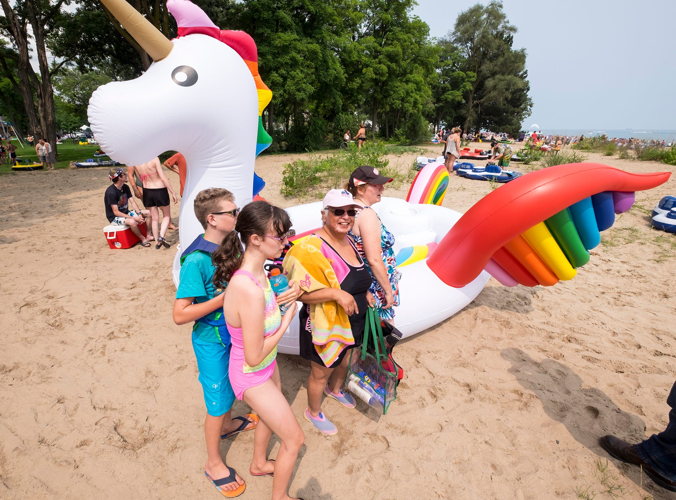 Christine Holst, Rosa Marino and the rest of their group wait by their inflatable unicorn Sunday, Aug. 19, 2018, before the annual Float Down launches from Lighthouse Beach.