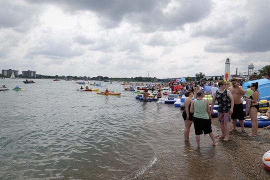 Lighthouse Beach is filled with participants for Sunday's Port Huron Float Down.