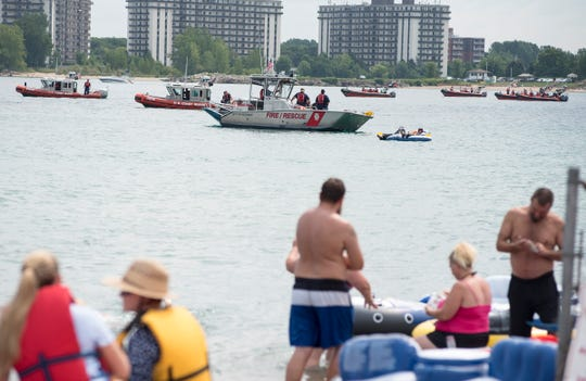 Emergency crews float near Lighthouse Beach Sunday, Aug. 19, 2018, before the annual Float Down launches.