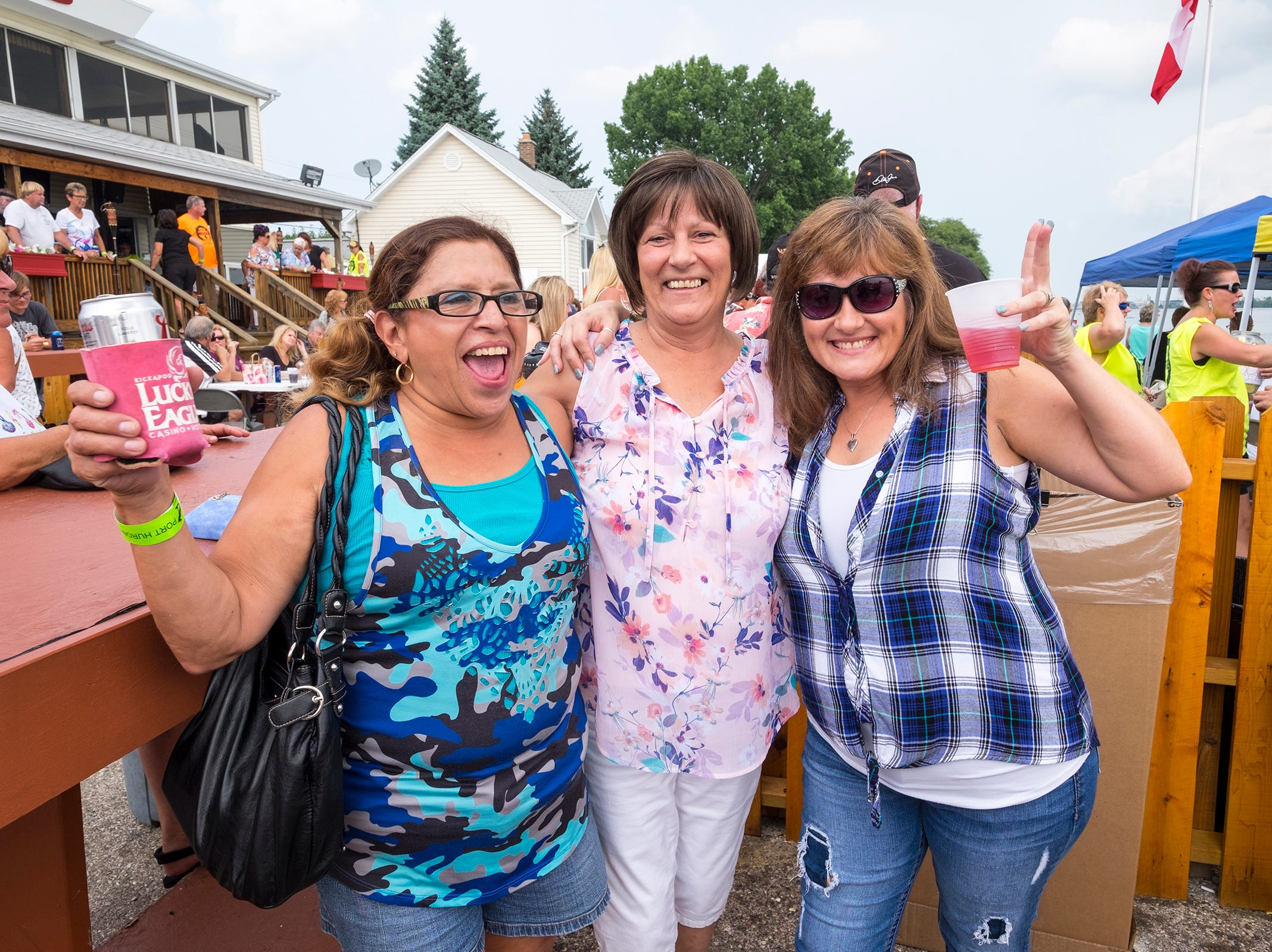 Mary Vicencio, Tina Sarazin and Tabatha Hegler stop for a photo Sunday, Aug. 19, 2018, during the Moose Lodge's annual Float Down party.