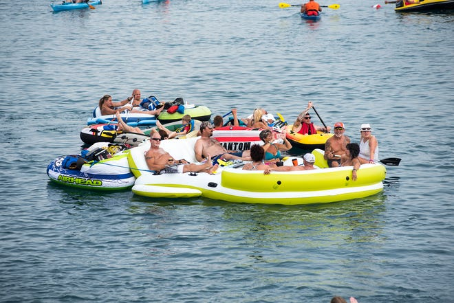 Groups of Float Down participants float near the Moose Lodge in Port Huron Sunday, Aug. 19, 2018, during the annual event.