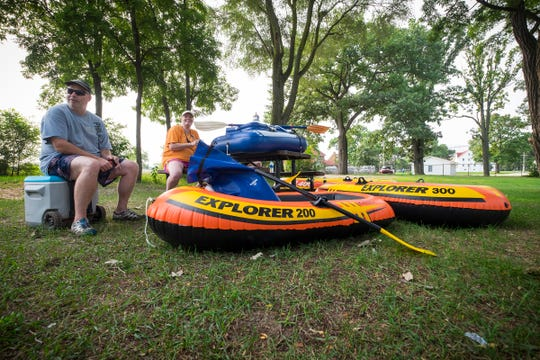 Sue Van Oppens and her husband Frank, both of St. Clair Shores, wait near Lighthouse Beach with their flotation devices Sunday, Aug. 19, 2018, before the annual Float Down launches. This will be Sue's second Float Down, and her husband's first.