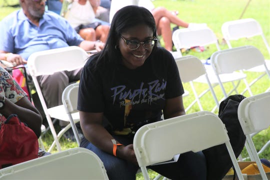 Lori Campbell, of the City of Poughkeepsie, smiles as she looks up from her program on Sunday. She and her mother were attending the annual event for the first time.