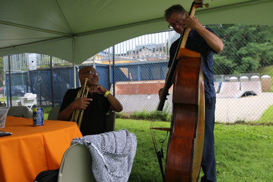 Trumpeter Eddie Henderson (left) and upright bassist Doug Weiss (right), a Town of Newburgh resident, smile as they warm up for their set. They're part of the band the Eddie Henderson Quintet.