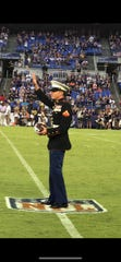 Kodi Bowers, 32, Greencastle, waves to the crowd during a home game for the Baltimore Ravens the evening of Aug. 9 in Baltimore, Md. Bowers was honored as a Hometown Hero by the football team for his service in the U.S. Marine Corps.