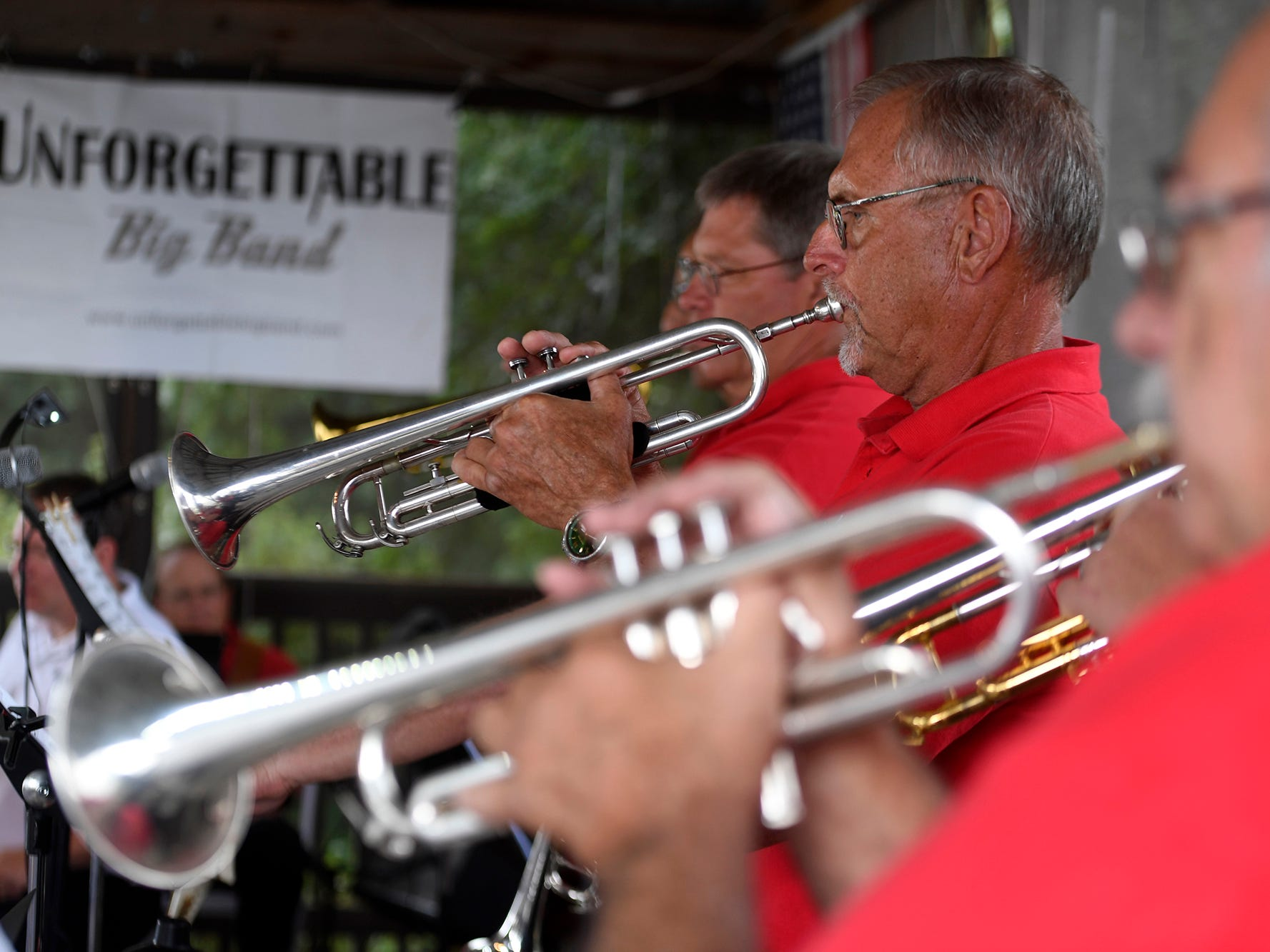 York's Unforgettable Big Band trumpet line, including Randy Gutacker, center, performs at Brown's Orchard & Farm Market, Sunday, August 18,  2018. John A. Pavoncello photo