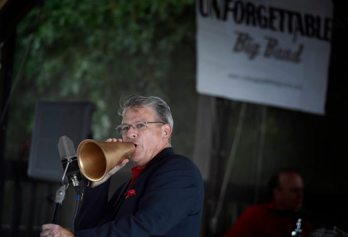 """Jame Scofield sings """"Puttin' On the Ritz"""" during Unforgettable Big Band's performance at Brown's Orchard & Farm Market, Sunday, August 18,  2018. John A. Pavoncello photo"""
