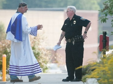 Richard Preston, Imperial Wizard of the Confederate White Knights of the Ku Klux Klan, left, talks with Gettysburg Police Chief Joe Dougherty outside the borough office in Gettysburg, on Saturday, Oct. 5, 2013. Around town, unity events were held to protest the beliefs of the KKK and its members.