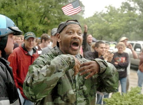 Craig Hill of Gettysburg shouts at members of the Ku Klux Klan while they leave a rally at the Gettysburg battlefield.  'I don't want them in my backyard,' Hill said.