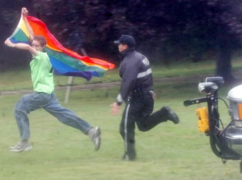 Sometimes protesters escalate Klan rallies. Here's an example from a past Klan rally in Gettysburg: A spectator carrying a rainbow flag is chased by a U.S. Park Police officer after he ran onto the barricaded lawn toward members of the Ku Klux Klan. The man was arrested and cited with entering a closed area.