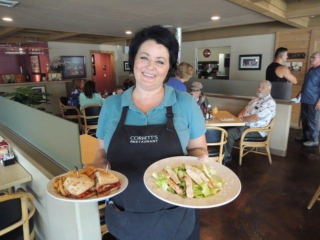 Dana Laughlin serves lunch order at Corbett's Restaurant on Pine Street in downtown Redding.