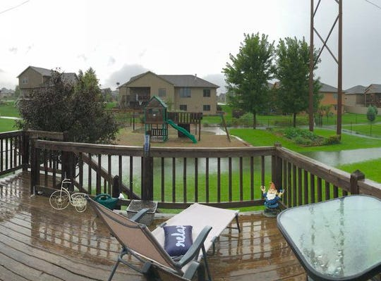 Flash flooding causes a river in the backyard of this western Sioux Falls home.