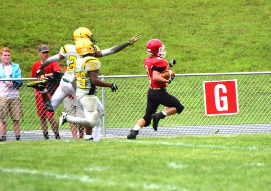 Riverheads running back Devin Morris stays just out of reach of Amelia County defenders as he scores a touchdown during their scrimmage at the Riverheads Jamboree on Saturday, Aug. 18, 2018, at Riverheads High School in Greenville, Va.