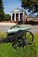 Route 56 winds past a cannon at historic Buckingham Courthouse. Residents are joining in opposition to the proposed pipeline.