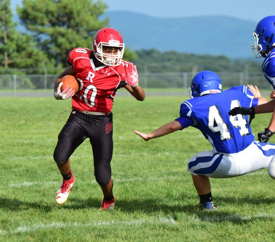 Riverheads running back D'ante Gray goes around right end during the Gladiators' scrimmage against Fort Defiance at the Riverheads Jamboree on Saturday, Aug. 18, 2018, at Riverheads High School in Greenville, Va.