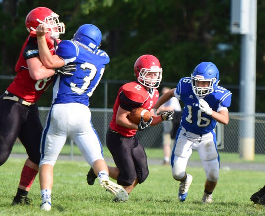 Riverheads running back Devin Morris finds a hole in the Fort Defiance line during their scrimmage at the Riverheads Jamboree on Saturday, Aug. 18, 2018, at Riverheads High school in Greenville, Va.