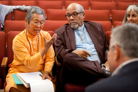 Swami Dayananda of Yogaville speaks to members of the Virginia Department of Environmental Quality. Next to her is Pastor Paul Wilson of Union Hill Baptist Church. MUST CREDIT: Photo by Timothy C. Wright for The Washington Post