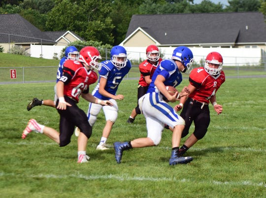 Fort Defiance quarterback Austin Monroe is stared down by Riverheads' Blake Smith, right, during their scrimmage at the Riverheads Jamboree on Saturday, Aug. 18, 2018, at Riverheads High School in Greenville, Va.