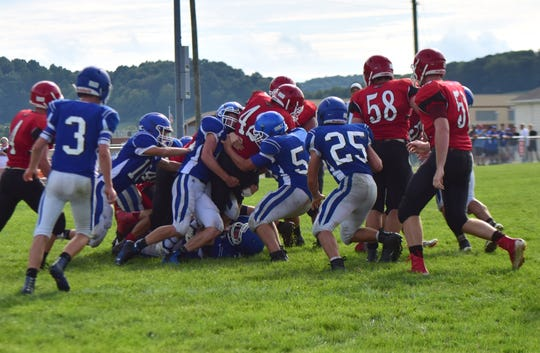 Fort Defiance's defense stands up Riverheads' Moose Lee at the line for no gain during their scrimmage at the Riverheads Jamboree on Saturday, Aug. 18, 2018, at Riverheads High School in Greenville, Va.