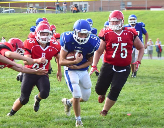 Riverheads' defense chases down Fort Defiance's Donald Seekford during their scrimmage at the Riverheads Jamboree on Saturday, Aug. 18, 2018, at Riverheads High School in Greenville, Va.