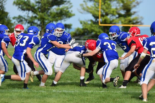 Fort Defiance's defense holds up Riverheads' Scott Vaughn during their scrimmage at the Riverheads Jamboree on Saturday, Aug. 18, 2018, at Riverheads High School in Greenville, Va.