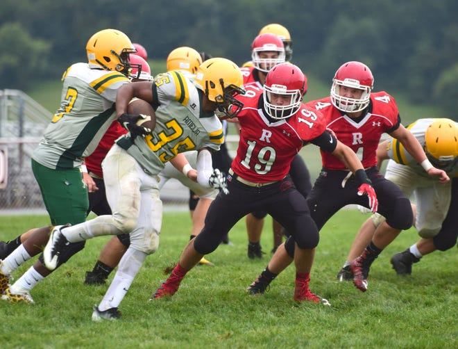 Riverheads' Forrest Shuey has his eyes on an Amelia County ballcarrier during their scrimmage at the Riverheads Jamboree on Saturday, Aug. 18, 2018, at Riverheads High School in Greenville, Va.