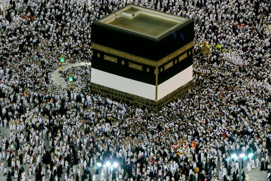 Muslim pilgrims circumambulate around the Kaaba in the Grand Mosque, before leaving for the annual Hajj pilgrimage in the Muslim holy city of Mecca, Saudi Arabia, early Sunday, Aug. 19, 2018. The annual Islamic pilgrimage draws millions of visitors each year, making it the largest yearly gathering of people in the world.