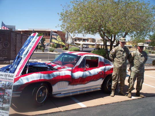 "Operation Bald Eagle's president, right, and vice president pose with the 1967 Corvette called ""The Spirit of America."""
