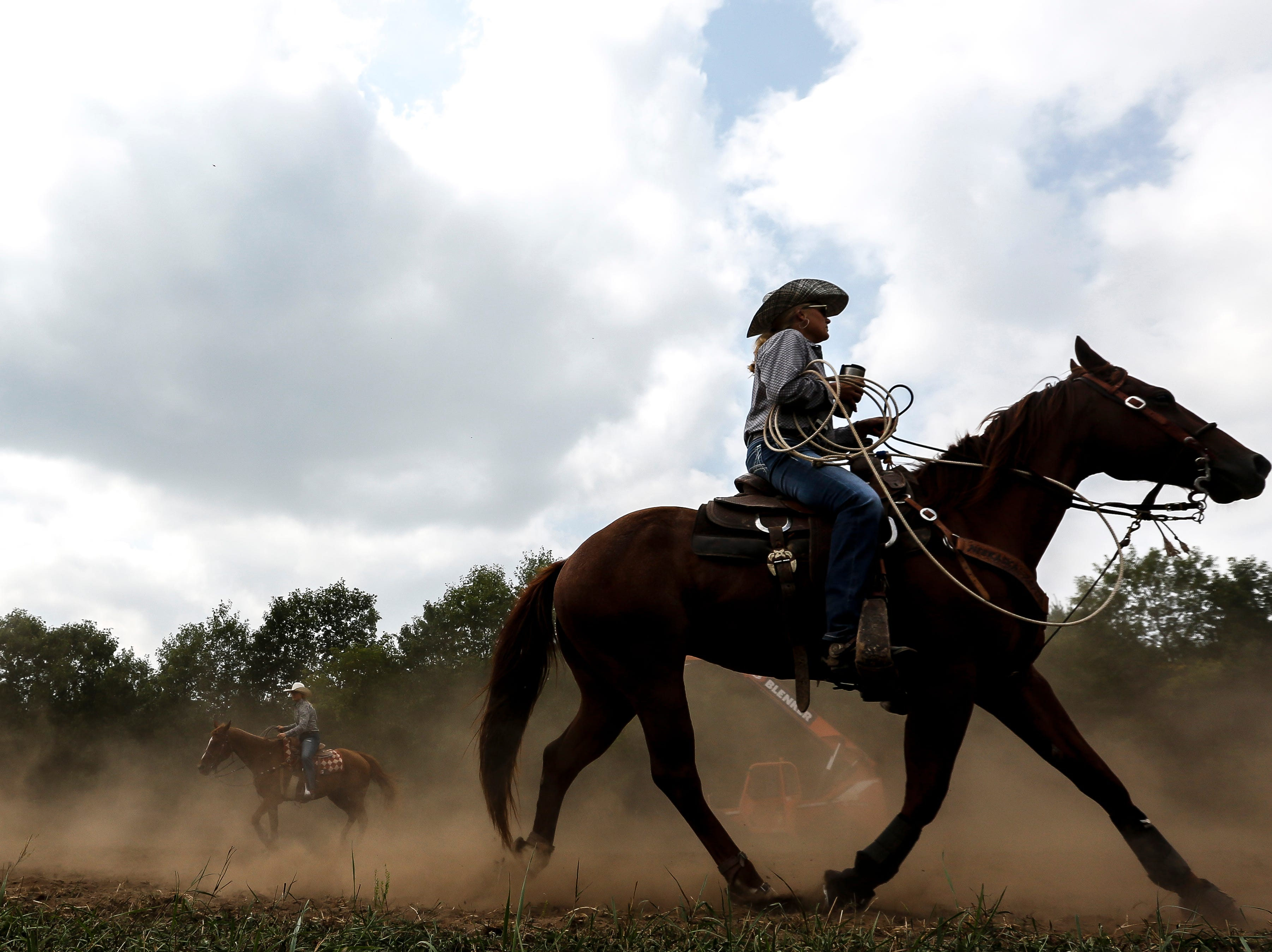 Competitors warm up during the Amherst Little Britches Wisconsin Rodeo in Amherst, Wis., August 17, 2018.