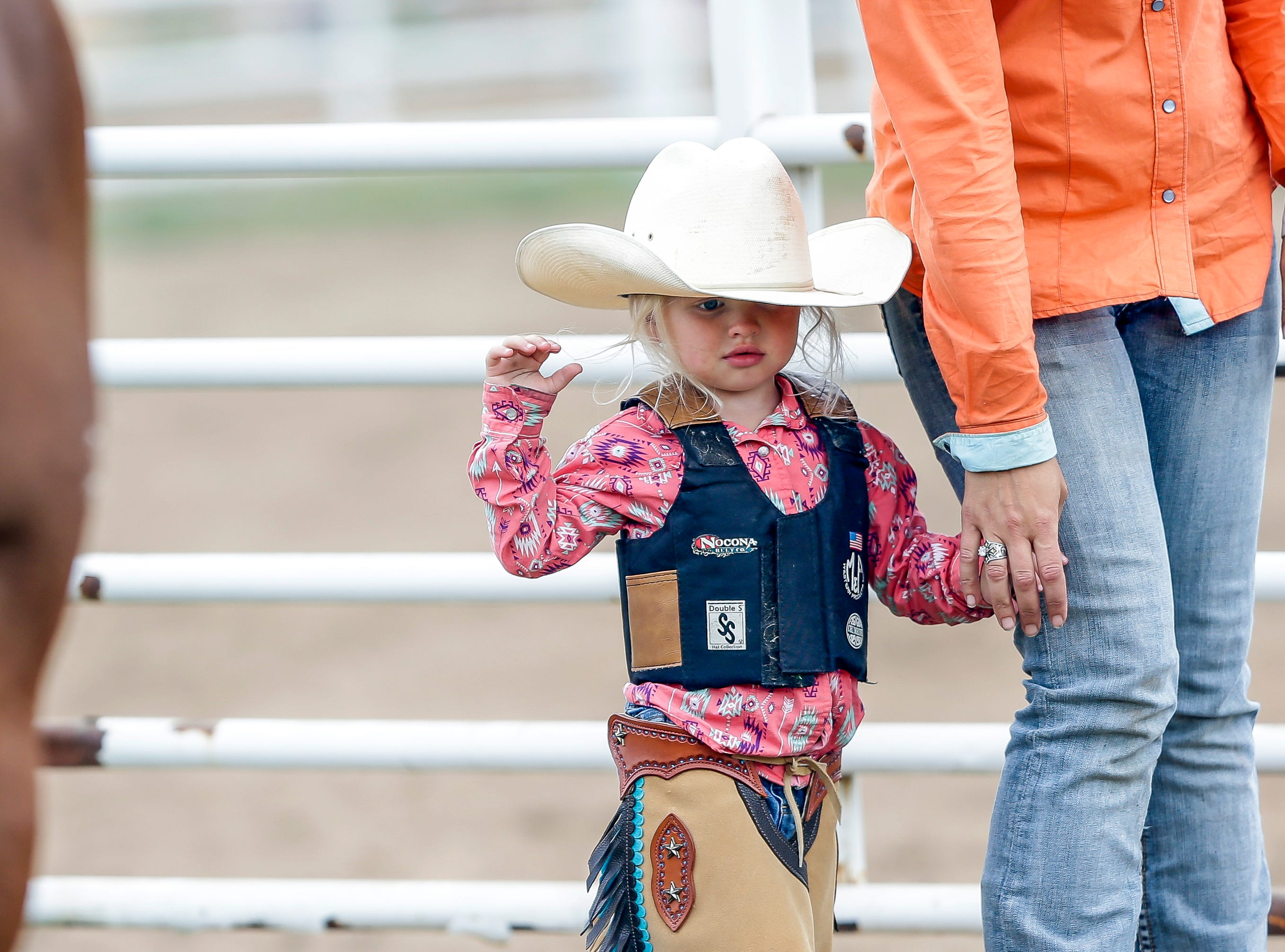 A girl walks through the fairgrounds during the Amherst Little Britches Wisconsin Rodeo in Amherst, Wis., August 17, 2018.