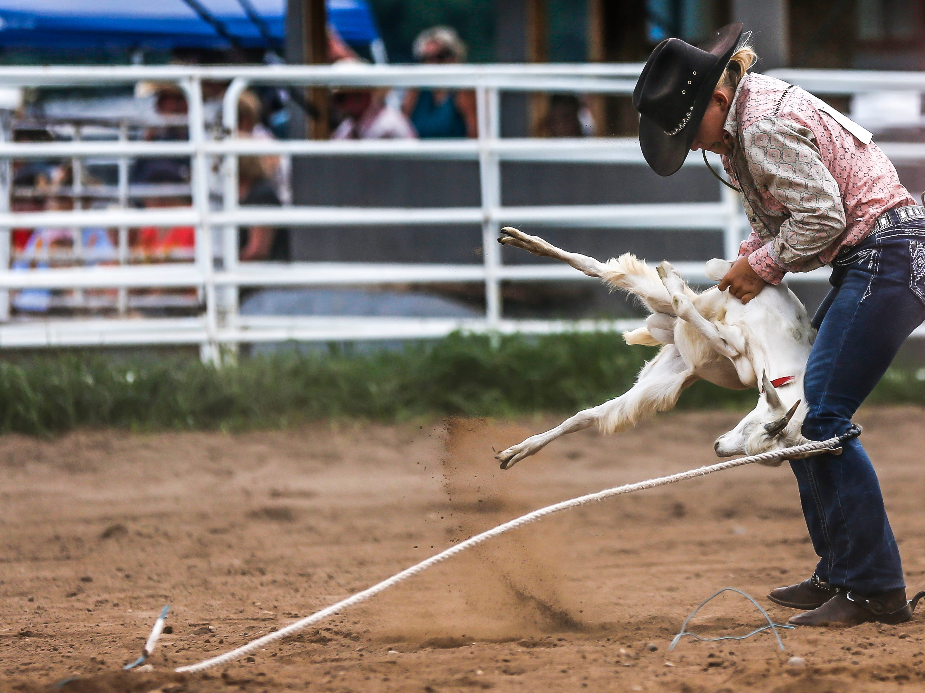 A competitor ties a goat during the Amherst Little Britches Wisconsin Rodeo in Amherst, Wis., August 17, 2018.