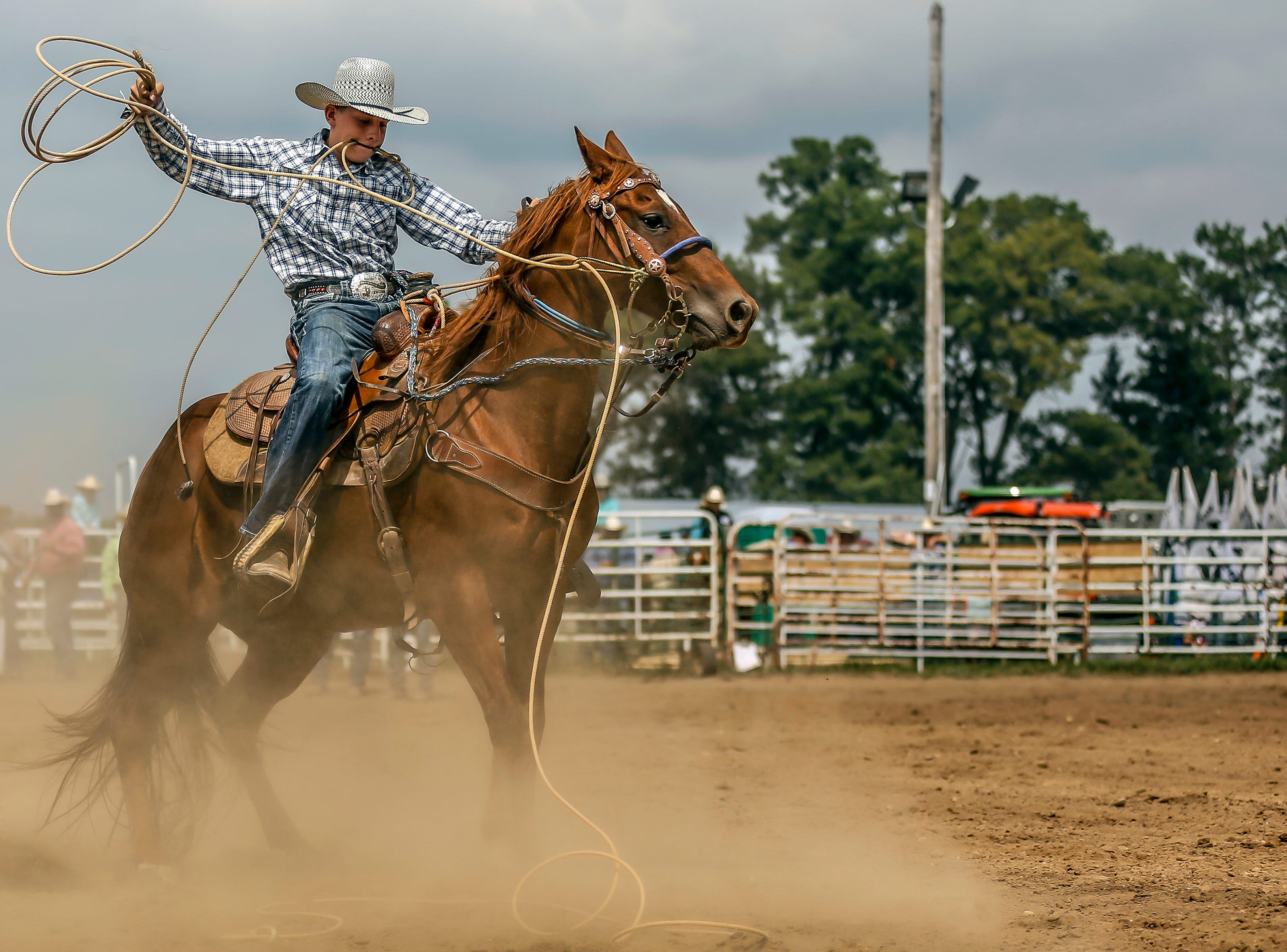 A competitor attempts to rope a calf during the Amherst Little Britches Wisconsin Rodeo in Amherst, Wis., August 17, 2018.
