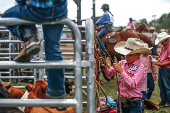 A boy practices his rope tying during the Amherst Little Britches Wisconsin Rodeo in Amherst, Wis., August 17, 2018.