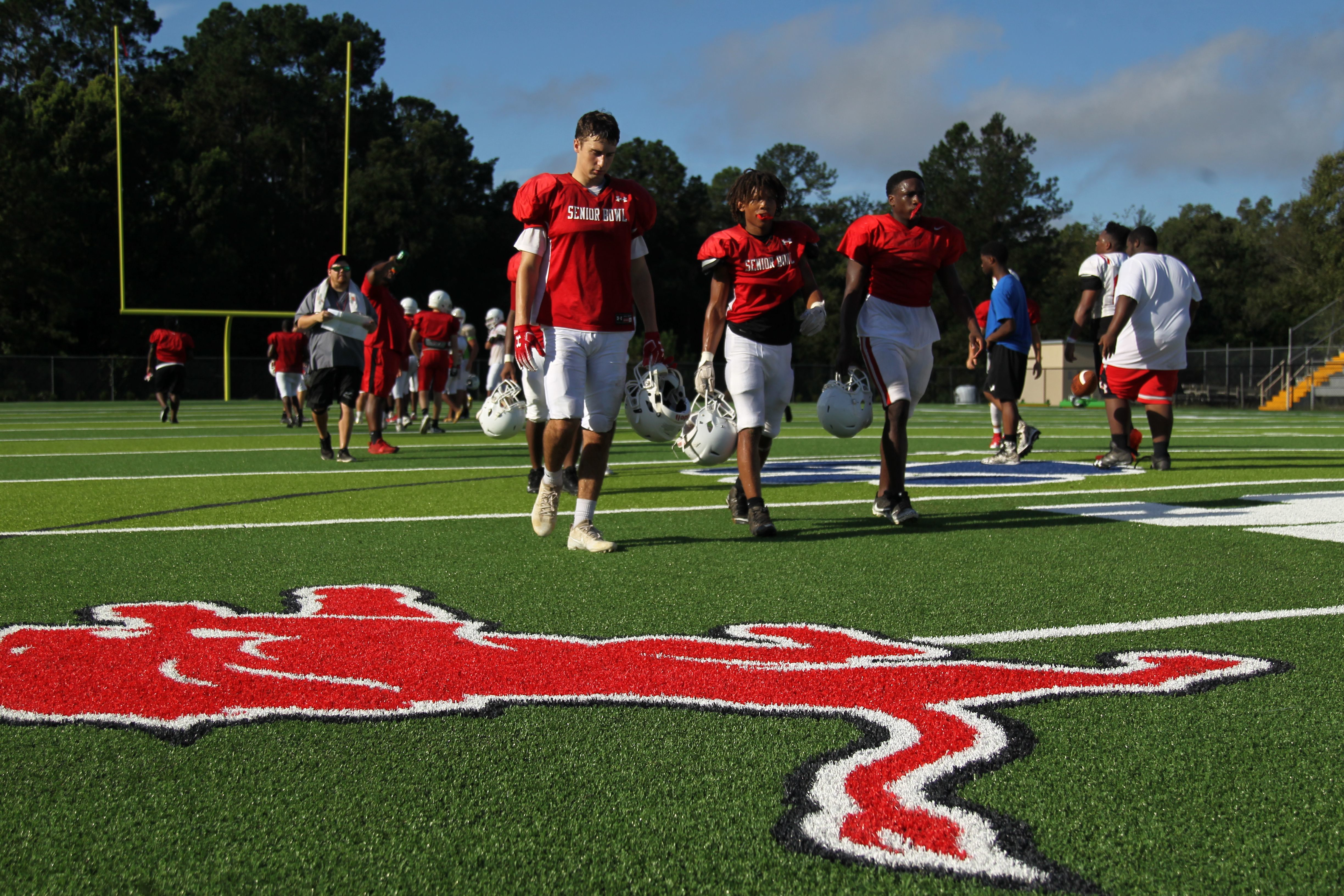 Leon's football team practices at Gene Cox Stadium on its new turf field on Tuesday, Aug. 7. Formerly Capital Stadium, Cox Stadium was dedicated to legendary Leon coach Gene Cox in 1997.