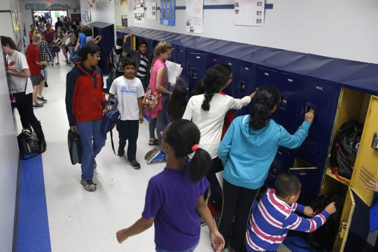 Students gather supplies from their lockers, in between class at Fairview Middle School in 2016. The school is slated for $20 million in upgrades.