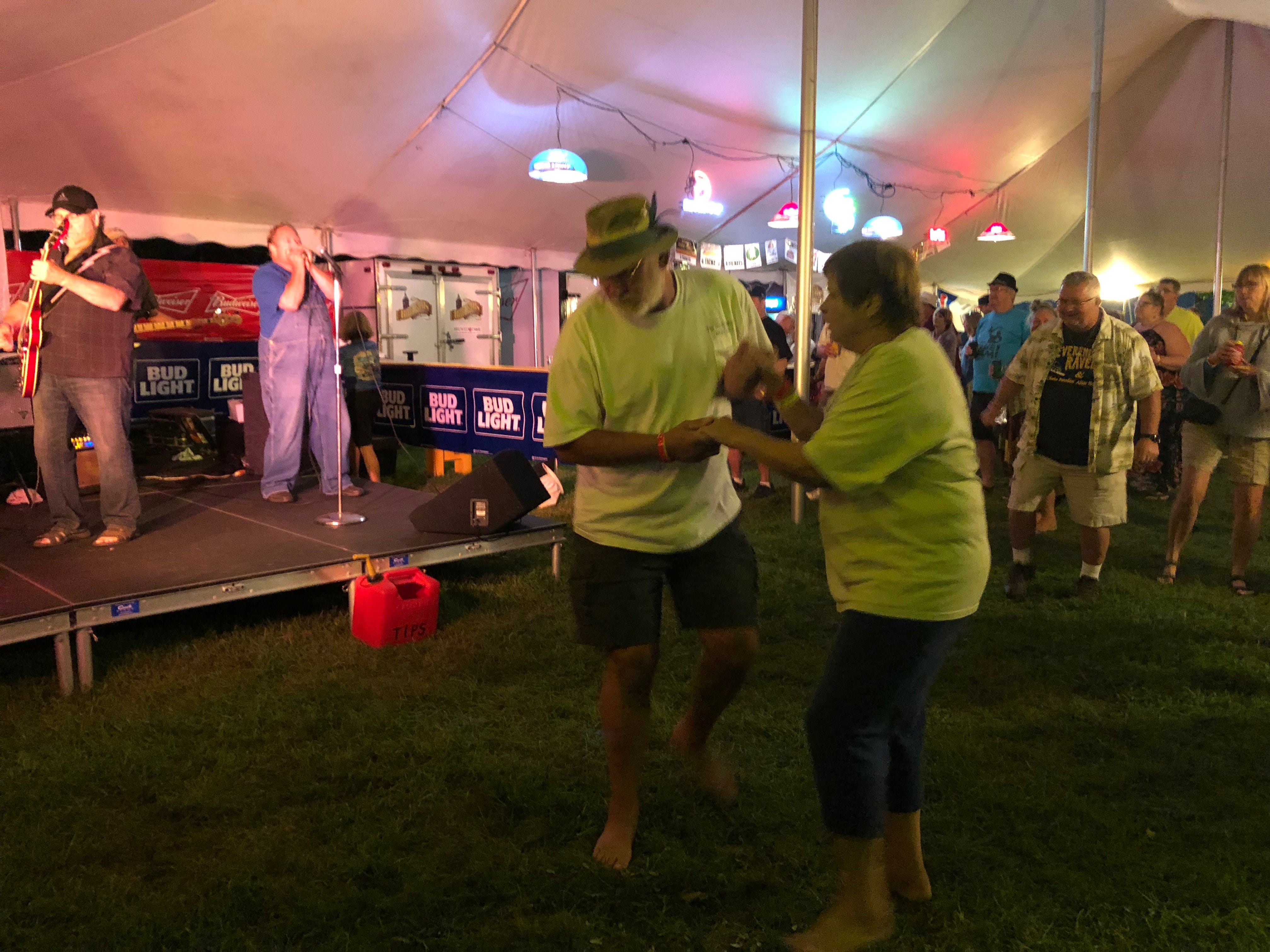 A couple dances as music plays at Big Bull Falls Blues Fest on Aug. 18, 2018.