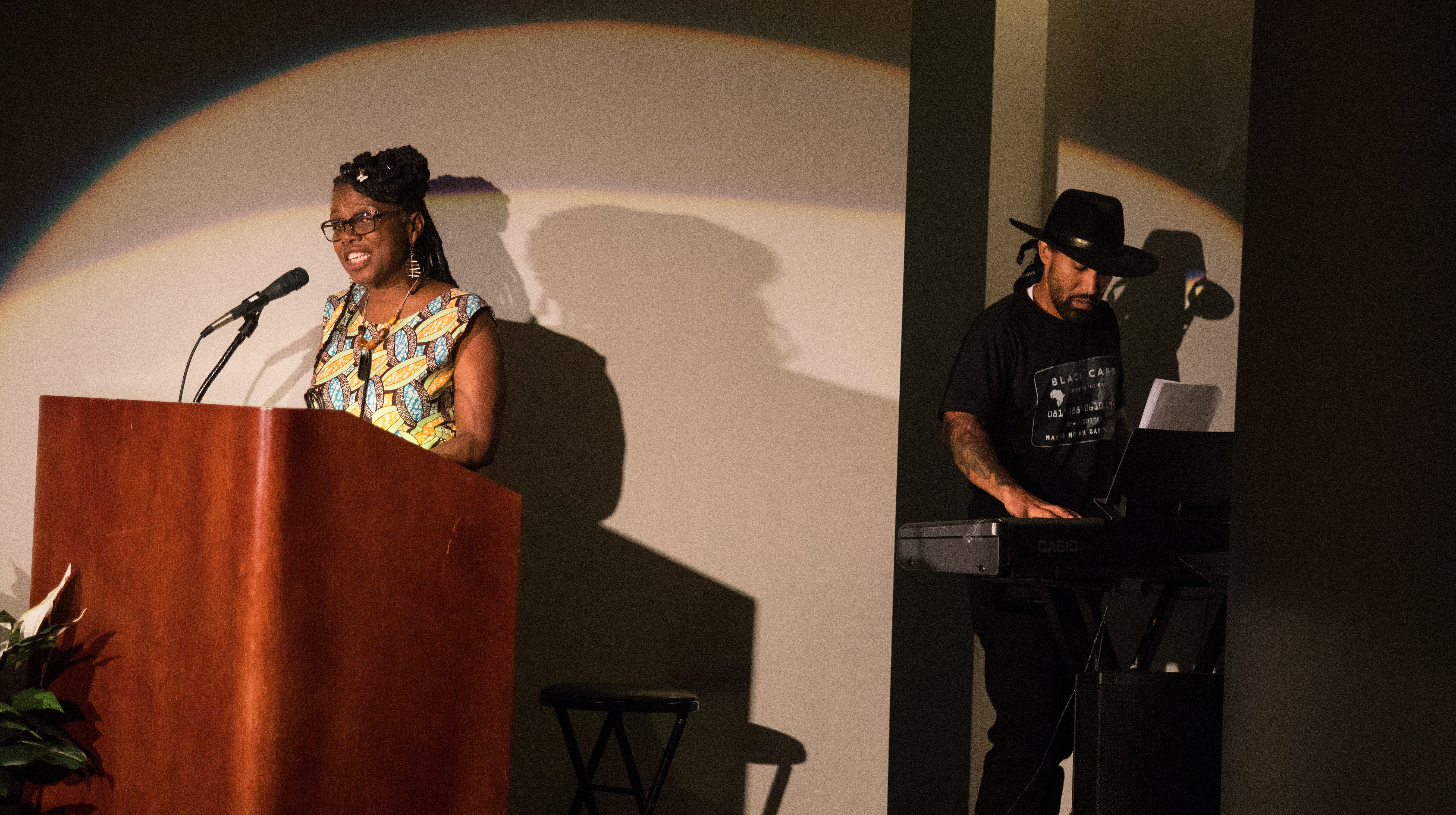 Local artist TAHIRA, left, and local singer/songwriter Jae Street Jr. perform during their multimedia performance of Unbroken Spirit Sunday at the Delaware Art Museum. The performance focuses on the occupation of Wilmington by the U.S. National Guard in 1968.
