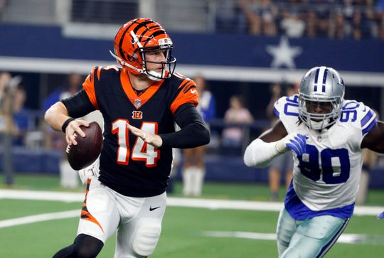 Cincinnati Bengals quarterback Andy Dalton (14) scrambles as he is pressured buy Dallas Cowboys defensive end Demarcus Lawrence (90) during the first half of a preseason NFL football game in Arlington, Texas, Saturday, Aug. 18, 2018. (AP Photo/Michael Ainsworth)
