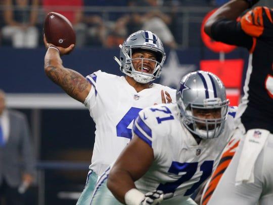 Dallas Cowboys quarterback Dak Prescott (4) throws behind offensive tackle La'el Collins (71) during the first half of a preseason NFL football game against the Cincinnati Bengals in Arlington, Texas, Saturday, Aug. 18, 2018. (AP Photo/Michael Ainsworth)