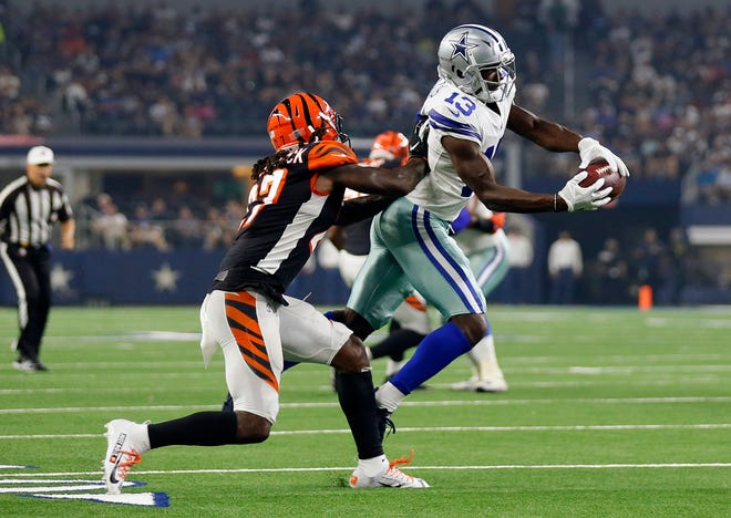 Dallas Cowboys wide receiver Michael Gallup (13) pulls is a catch in front of Cincinnati Bengals defensive back Dre Kirkpatrick (27) during the first half of a preseason NFL football game in Arlington, Texas, Saturday, Aug. 18, 2018. (AP Photo/Roger Steinman)