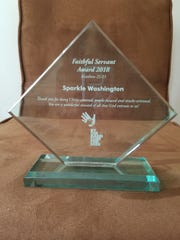 Native Wichitan Sparkle Washington was honored with the Faithful Servant 2018 award from By the Hand Kids Club. The award recognizes that the recipient embodies the spirit of the organization and has demonstrated faithful service during her time at the nonprofit organization. Washington is the third recipient of the award from the organization where she works as team coach for By the Hand Club for Big Kids.  The organization seeks to help youth on their journey from the day of their first visit through college, tending to mind, body and soul.