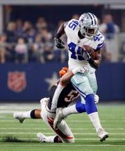 Dallas Cowboys running back Rod Smith (45) works to break away from Cincinnati Bengals linebacker Jordan Evans (50) during the first half of a preseason NFL Football game in Arlington, Texas, Saturday, Aug. 18, 2018. (AP Photo/Ron Jenkins)