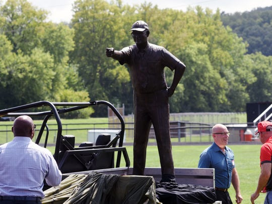A statue of Woody Hayes was unveiled on Saturday during a ceremony at Lee Stadium in Newcomerstown. It was built by Zanesville native Alan Cottrill, who also built the eight-foot statue of Hayes at the Woody Hayes Athletic Facility in Columbus. The ceremony included two-time Heisman Trophy winner Archie Griffin, left.