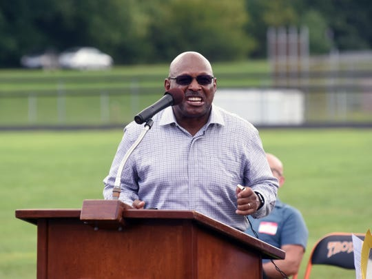 Two-time Heisman Trophy winner Archie Griffin gives an impersonation of former Ohio State coach Woody Hayes during a speech on Saturday at Lee Stadium in Newcomerstown, Hayes' hometown. Griffin was in attendance for the unveiling of a statue built in Hayes' honor.