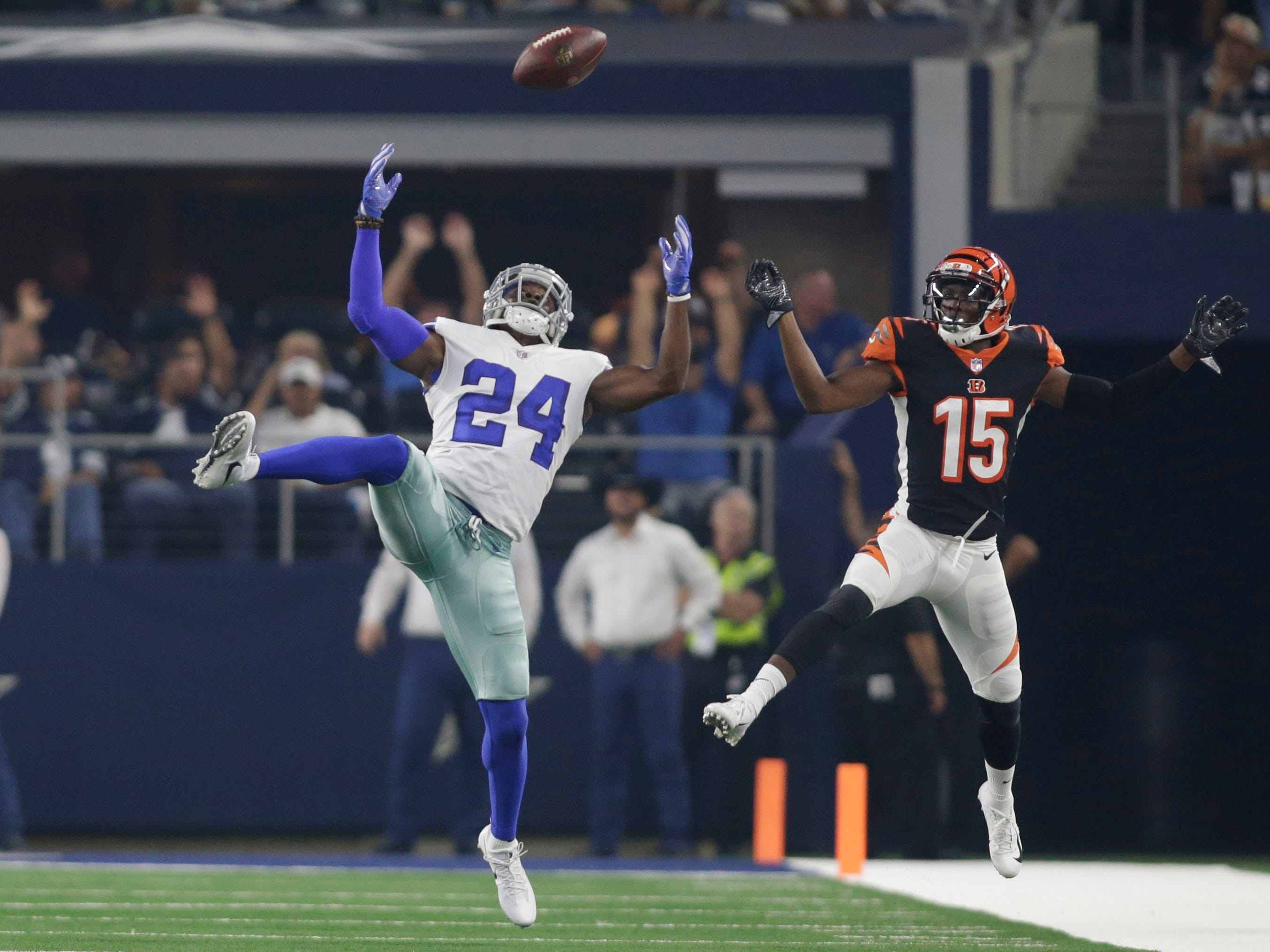 Cowboys cornerback Chidobe Awuzie (24) knocks away and intercepts a pass intended for Bengals receiver John Ross (15) during the second quarter at AT&T Stadium.